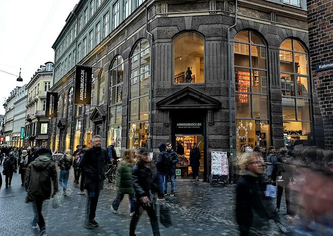 Rival overtager halvdelen af Arnold Buscks butikker